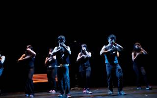 Dancers from UCL Malaysian Soc on stage in a theatre.