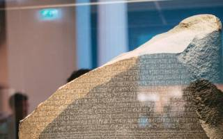 The top of the Rosetta Stone in a glass case.