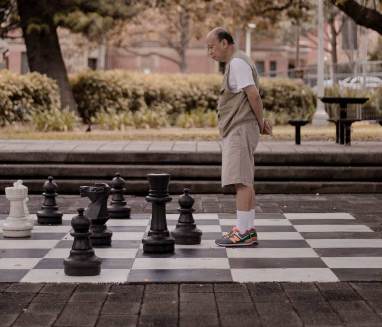 man playing large chess