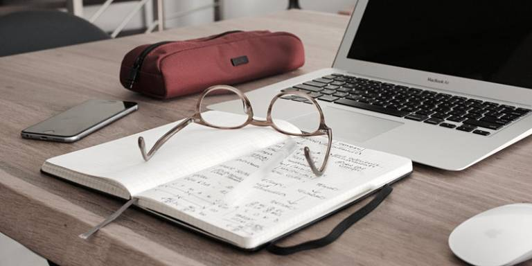 laptop, glasses and notebook