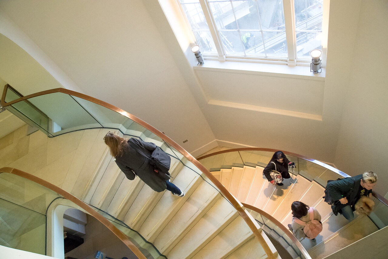 People on stairs in the Main library UCL