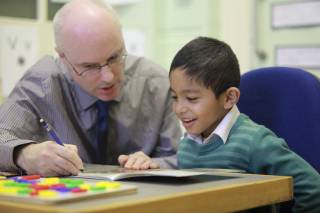 Teacher and a boy at Reading Recovery lesson