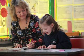 Teacher and child at the Reading Recovery lesson
