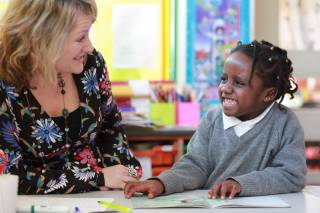 teacher with a child at the Reading Recovery lesson