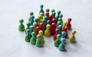 Multi coloured wooden abstract figures clustered together