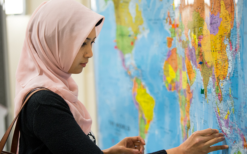 Global Engagement - an image of a woman looking at a map