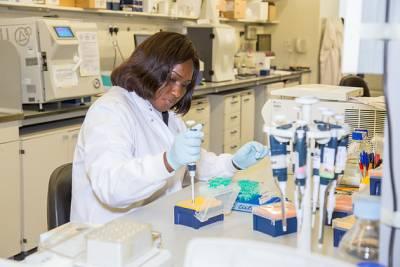 Female Scientist working at lab bench