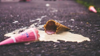 Ice cream cone fallen on pavement