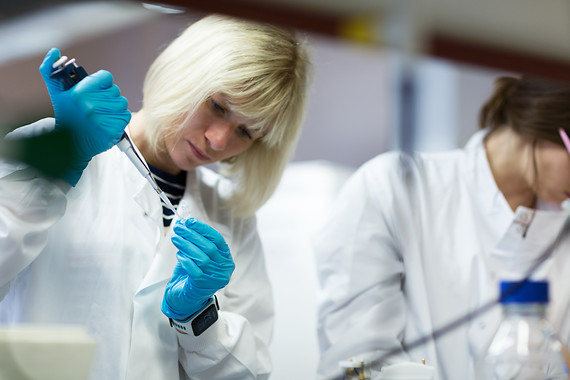 Woman scientist working at lab bench