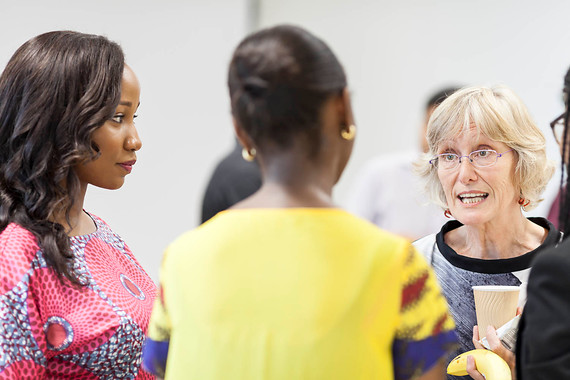 Networking event with women talking to each other