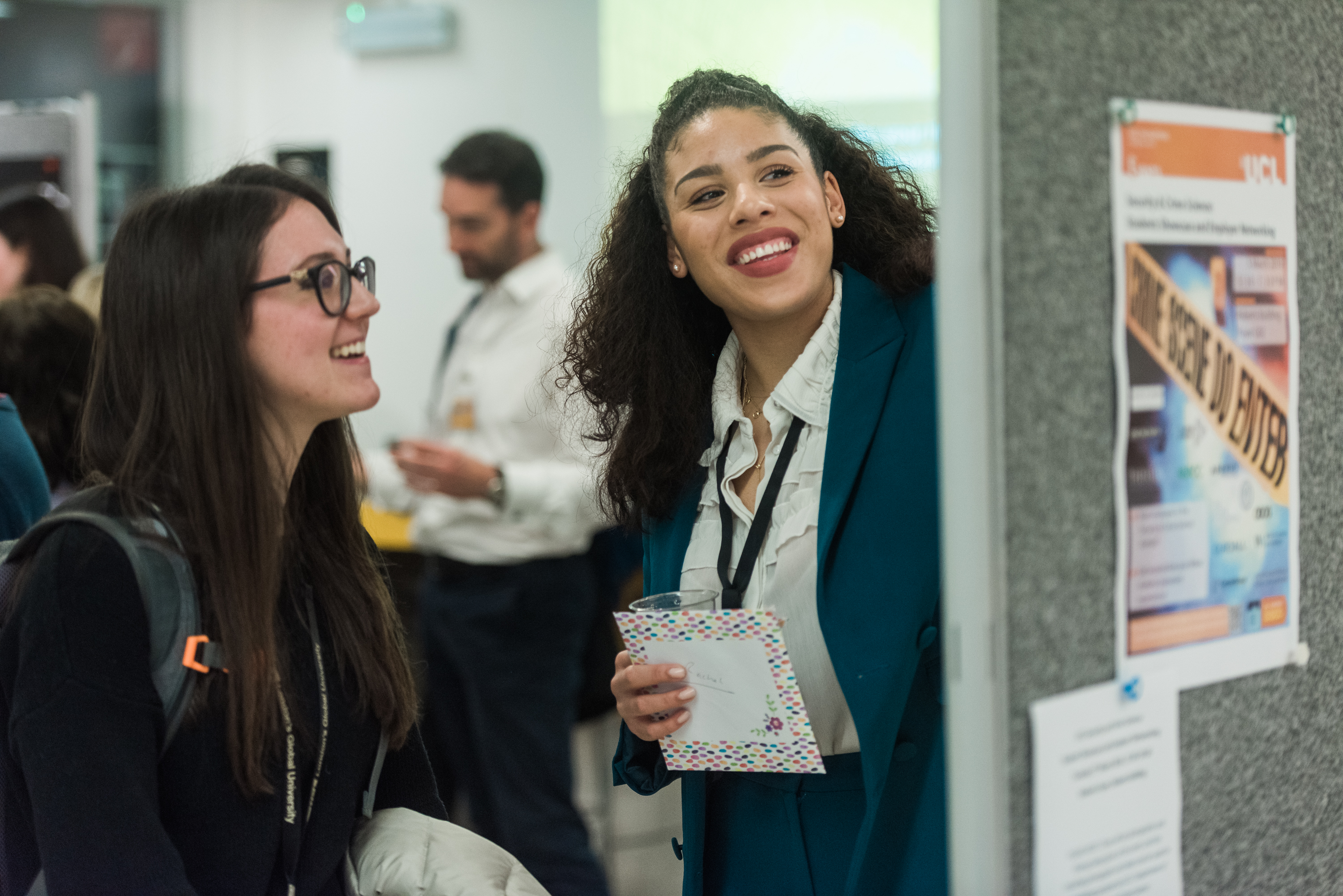 Students talking at poster event
