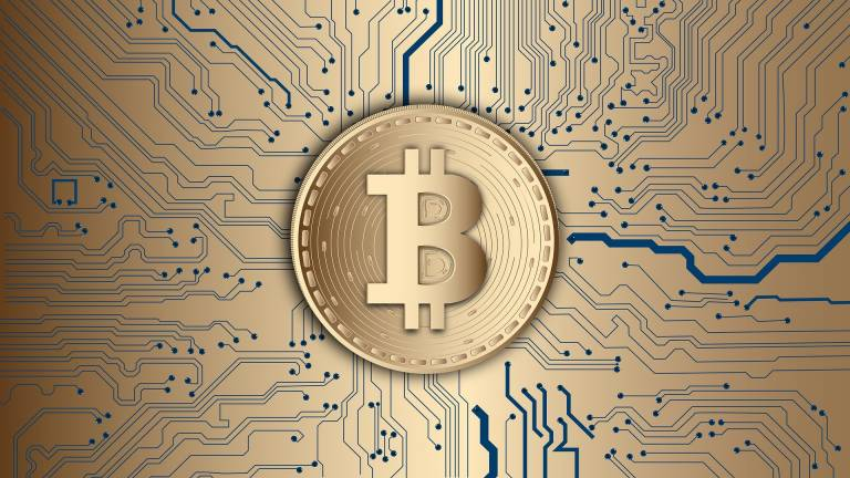 Bitcoin logo surrounded by gold coins