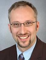 Dr Christian K. Schneider