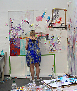 Woman painting in studio