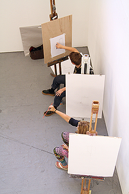 Two people in drawing studio