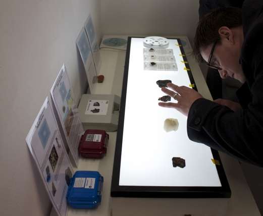 A researcher inspects some desert glass during the Lunar Salon