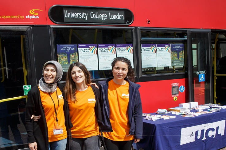 Student helpers stood next to UCL big red bus