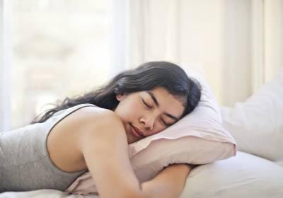 Girl asleep in grey vest top