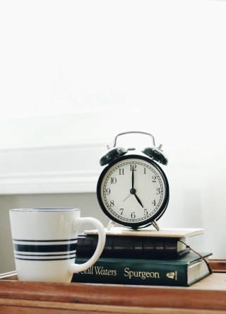 Alarm clock on stack of books