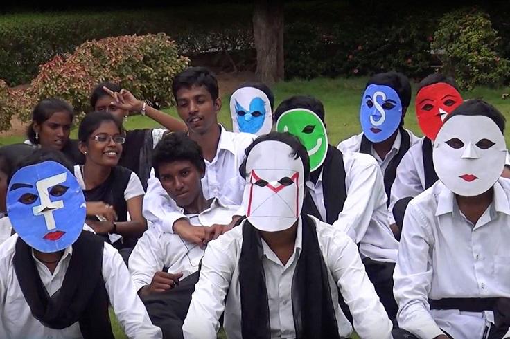 Students wearing social media masks