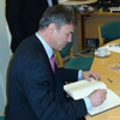 Bulgarian Minister of Education, Sergei Ignatov, signs the visitor's book.…
