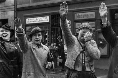 People of Cheb salute German troops entering the town in October 1938…