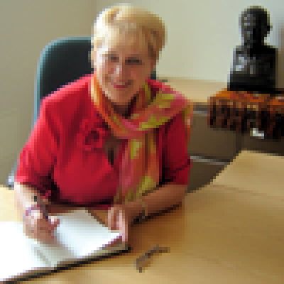 Baiba Rivža signs the Visitor's Book during her visit to SSEES…