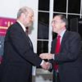 Professor Michael Arthur shakes hands with Professor Jan Kubik…