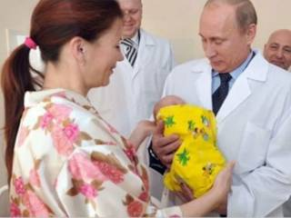 Putin holding a baby