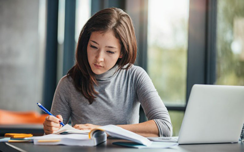 Female student working at a desk