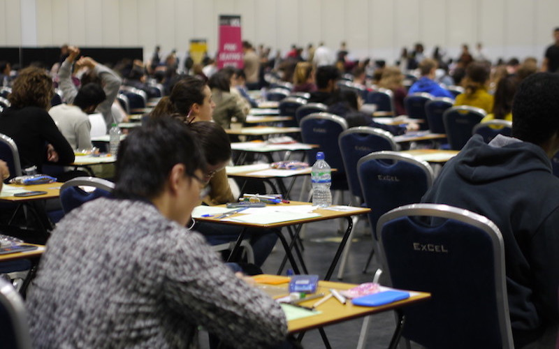UCL students taking exams at Excel