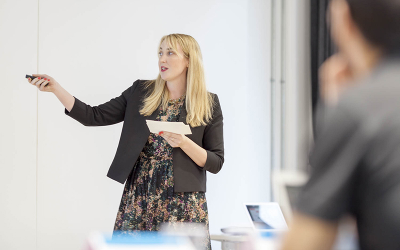 Woman giving a PowerPoint presentation