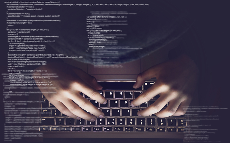 Image of hands over a keyboard