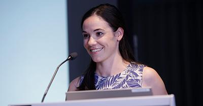 Ellie Cosgrave speaking at event