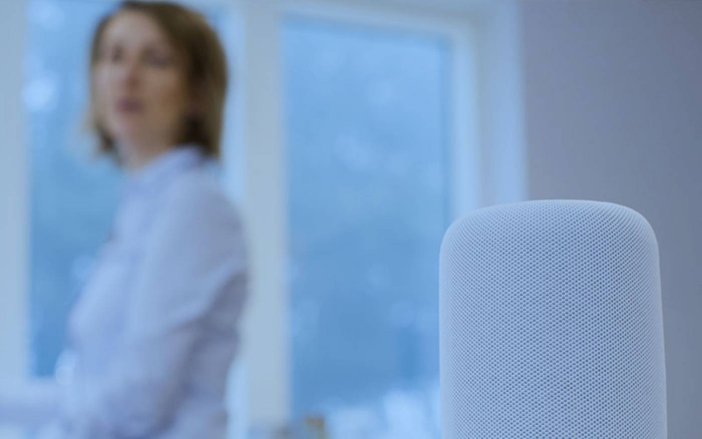 Image of a woman with a smart device