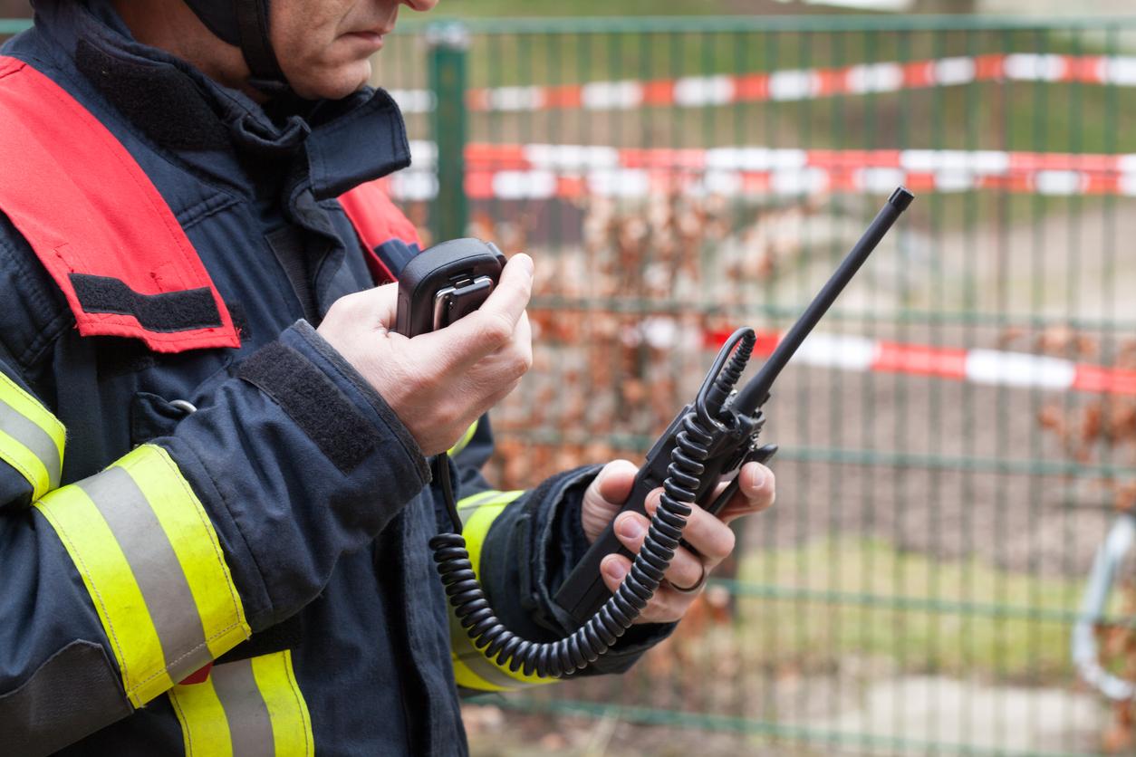 Image of firefighter on walkie talkie