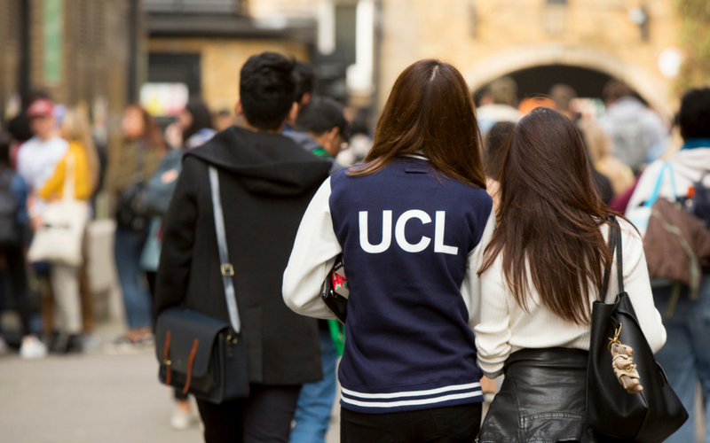 Girl with UCL jacket in the South Quad