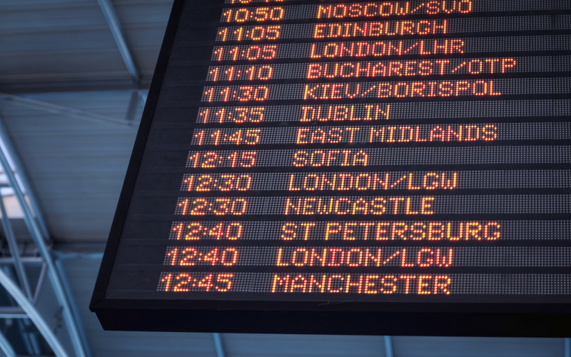 Arrivals board showing numerous cities including London
