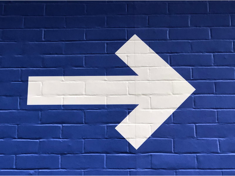 Arrow on a wall pointing right