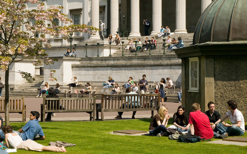 The UCL Front Quad in the summer, with students relaxing and talking to each other