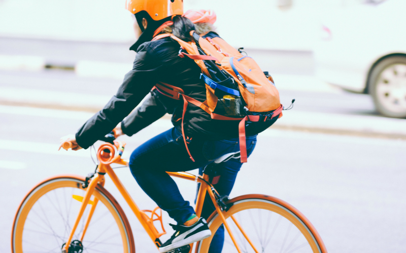 Cyclist with bag and helmet