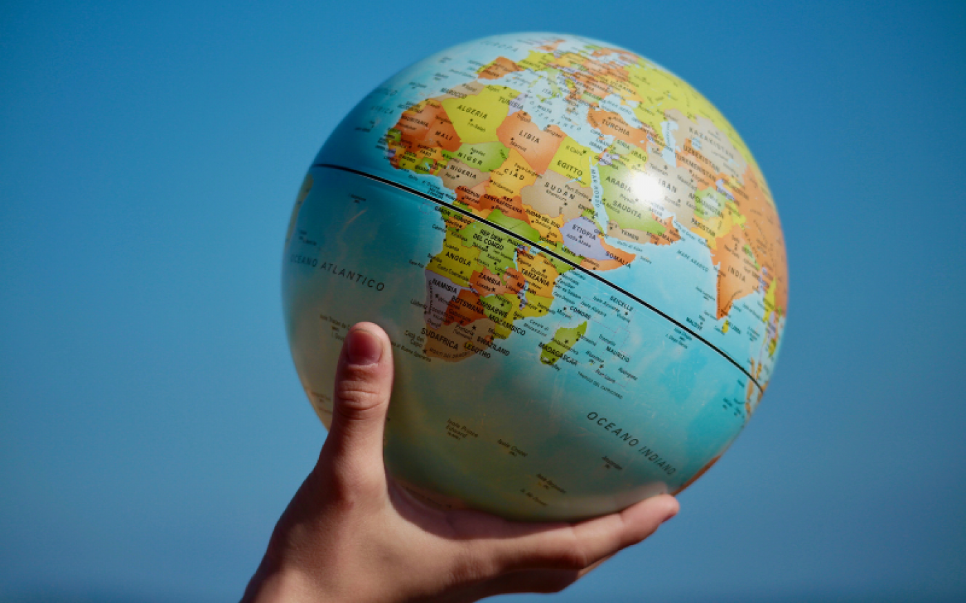 A globe in someone's hand