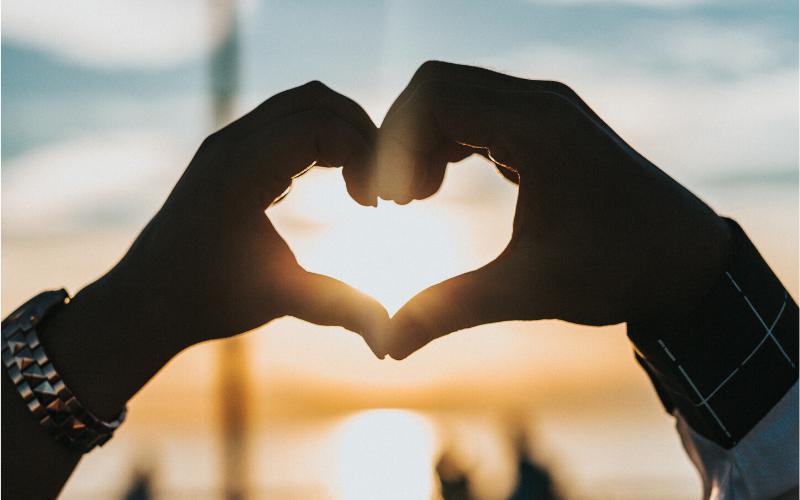 Hands held in heart shape