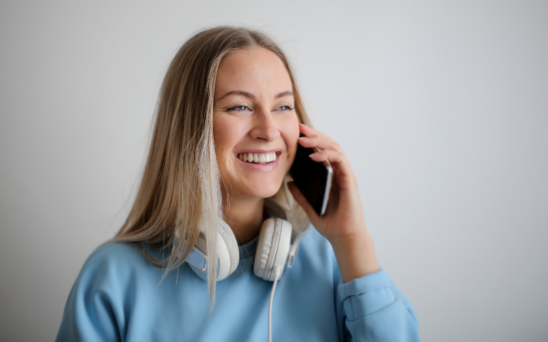 A student smiling while talking on the phone