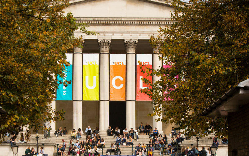UCL Portico with trees and 'UCL' flags