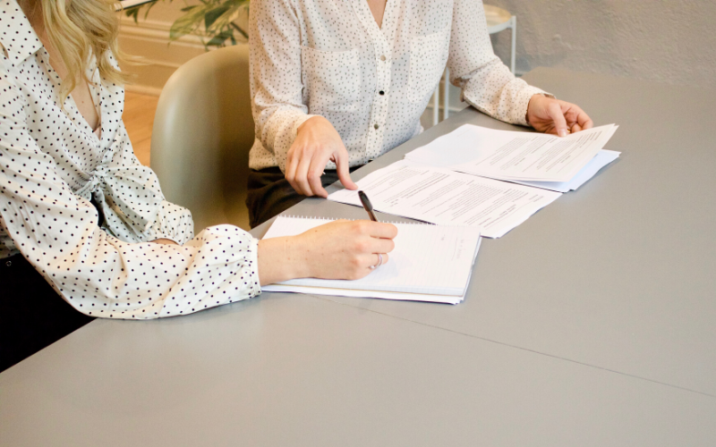 two people looking at a contract
