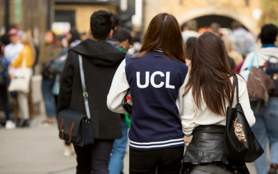 Female student wearing 'UCL' jacket
