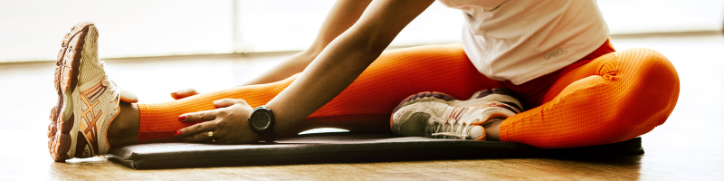 A person's legs while stretching