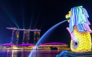 A view of Singapore showing the merlion statue and Marina Bay Sands