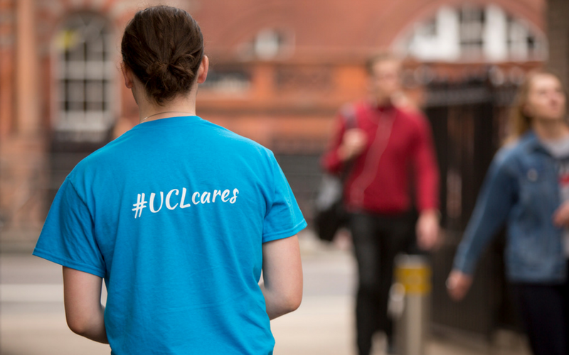 Back of staff member in #UCLcares tshirt on main campus